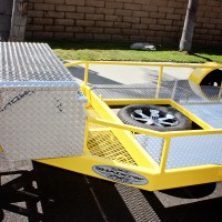 Mesh Storage Area, Spare Tire Location, 5 ft Polished Aluminum Diamond Plate Box and Deck.